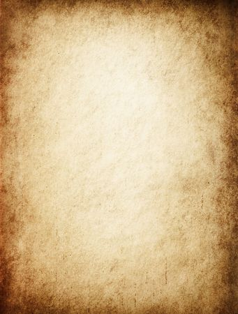 Antique yellowish parchment paper grungy background texture Stock Photo