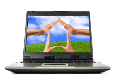 Conceptual Home symbol on a laptop computer display Real Estate Environmental technology concept photo