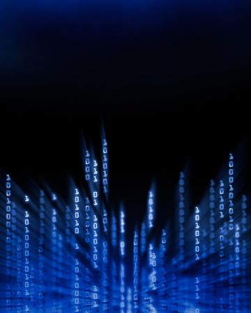 Glowing binary code data digits flowing on computer display photo