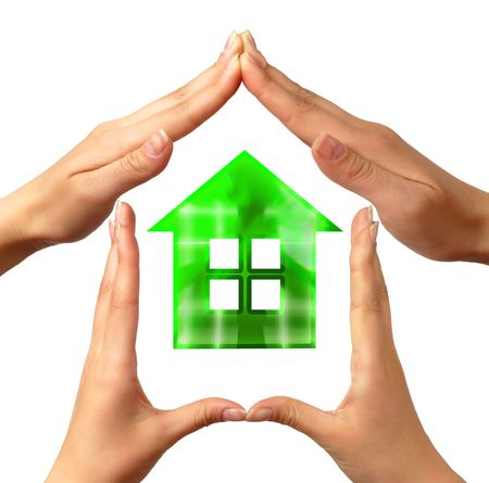 Conceptual home symbol made by hands Stock Photo