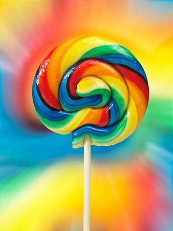 Colorful appetizing lollipop on colorful background isolated with clipping path photo