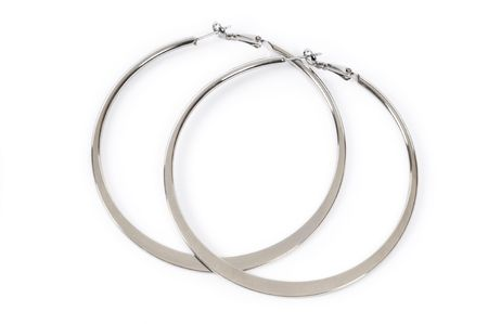 silver jewelry: Large ring shaped earrings isolated on white background Stock Photo