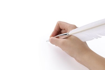 Woman holding a quill pen in a hand. Isolated on white background with clipping path. Stock Photo