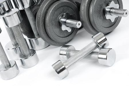 shiny: Shiny metal dumbbells. Exercise equipment. Stock Photo