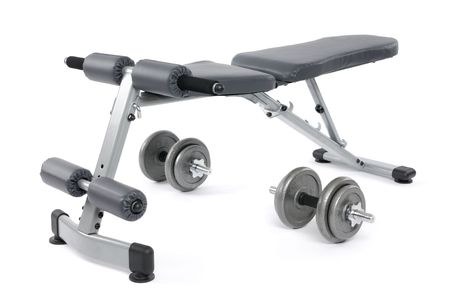 machines: Exercise bench and dumbbells. Gym equipment isolated on white background. Stock Photo