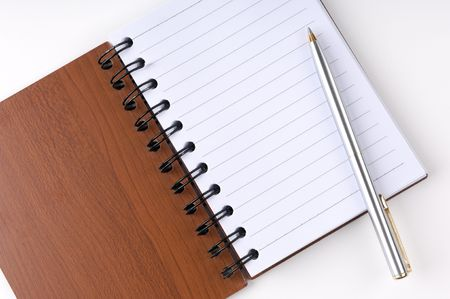 Open notepad with a pen photo