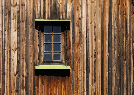 wood textures: Old wooden building close up of a wall with a window