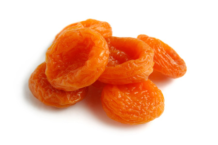 upclose: Dried apricots close-up Isolated over white background Stock Photo
