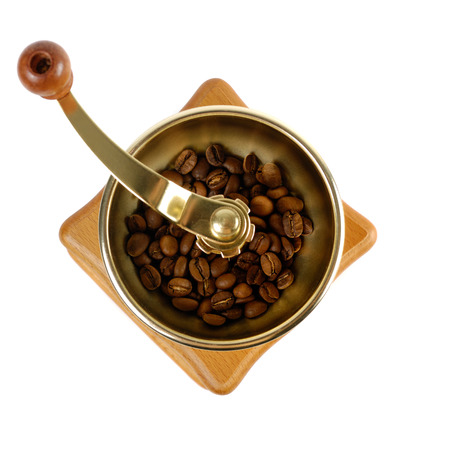 cut out device: Coffee grinder with coffee beans close-up Isolated over white background