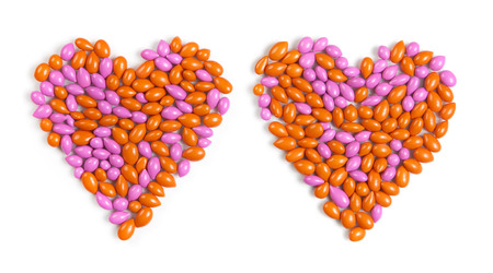 dragee: Two hearts made by colorful dragee candies isolated on white background Stock Photo