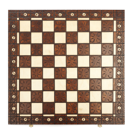 chessboard: Wooden chess board isolated on white background