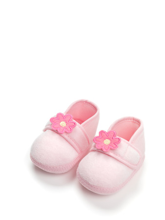 baby shoes: Baby girl pink shoes isolated on white background Stock Photo