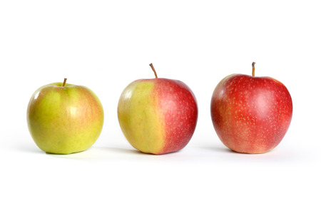 ripening: Three apples. Green, half red and red. Isolated on white background