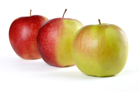 Three apples. Green, half red and red. Isolated on white background photo