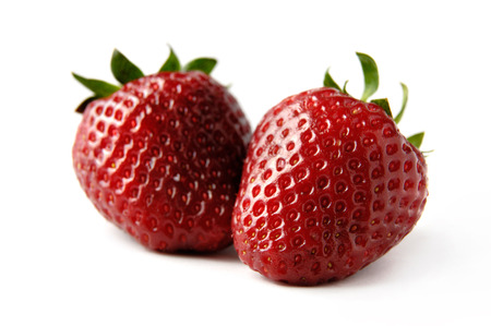 upclose: Two red strawberries Isolated close-up over white background