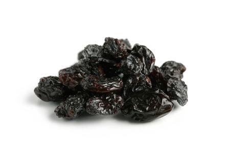 upclose: Black raisin close-up Isolated on white background