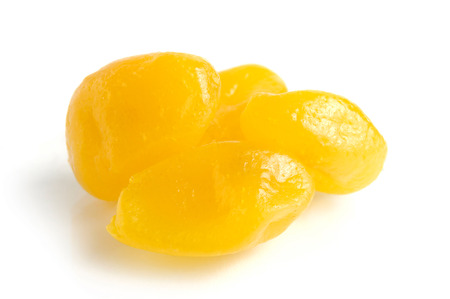 upclose: Dried lemons in sugar syrup close-up Isolated over white background Stock Photo