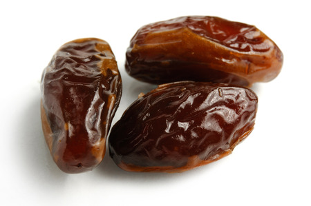 pitted: Dried Kabkab dates close-up Isolated over white background Stock Photo