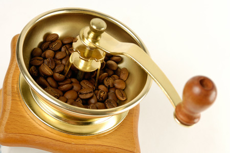 cut out device: Stock photo of a Coffee grinder with coffee beans close-up Isolated over white background