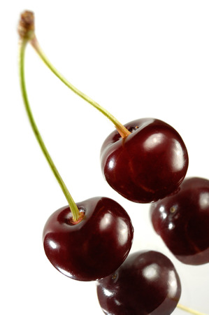 upclose: Two cherries close-up Isolated on white background