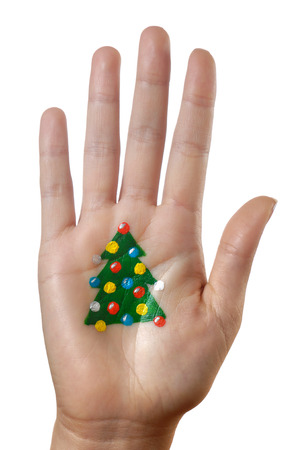 body parts: Christmas tree pattern painted on a palm isolated on white background