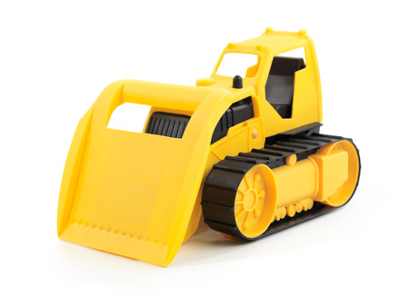 Yellow toy bulldozer isolated on white background photo