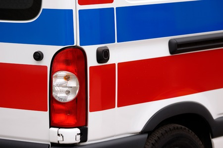 taillight: Ambulance vehicle red and blue stripes close-up