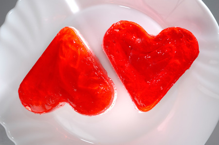 Two heart-shaped appetizing cakes on a plate food still life photography. Love, romantic, Valentines concept photo