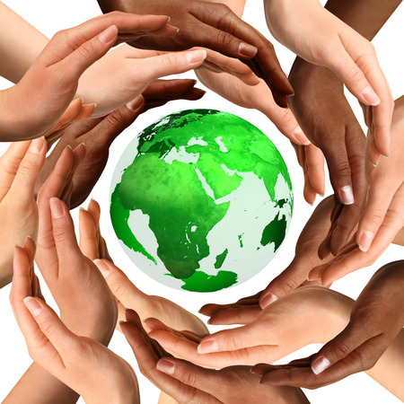 Conceptual symbol of a green Earth globe with multiracial human hands around it. Isolated on white background. Unity and world peace concept. photo