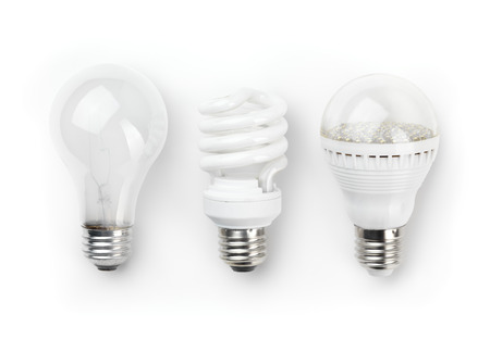 lamp light: Three generations of light bulbs. Regular incandescent, energy saving fluorescent and LED isolated on white background with clipping path Stock Photo