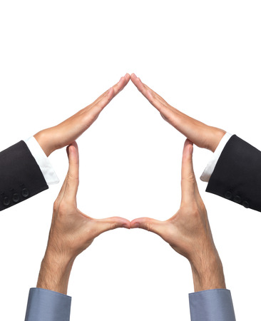 Conceptual house symbol made by hands of a woman and a man. Isolated sign on white background. photo