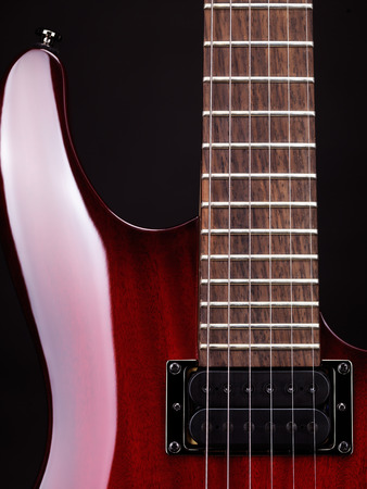frets: Closeup of electric guitar neck, strings and pickup Stock Photo