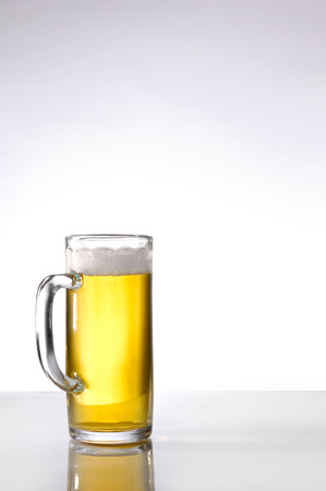 Glass with light beer isolated on white background with copyspace on top photo