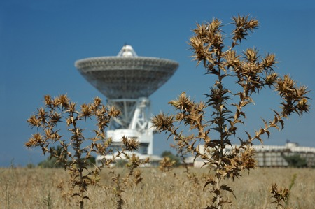 atomic center: Radioactive waste and pollution - Sattelite dish on dry field environmental concept. The dish was shot in the Crimea, Ukraine Stock Photo