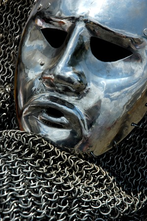 Antique metal helmet shining chrome mask and chain mail.