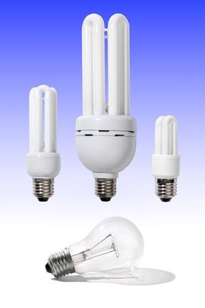 watt: Three energy-efficient light bulbs of different power 5, 15 and 40 Watt above a regular 120 Watt light bulb Power saving economy electricity moder technologies concept Stock Photo