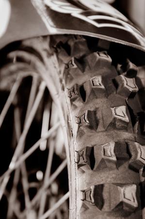 tire tread: Artistic close-up of a racing bike tire tread Sepia toned
