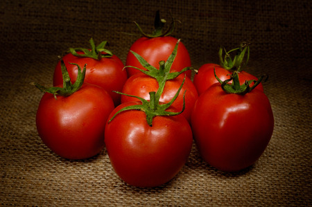 tomatos: Appetizing tomatoes light-painted still life