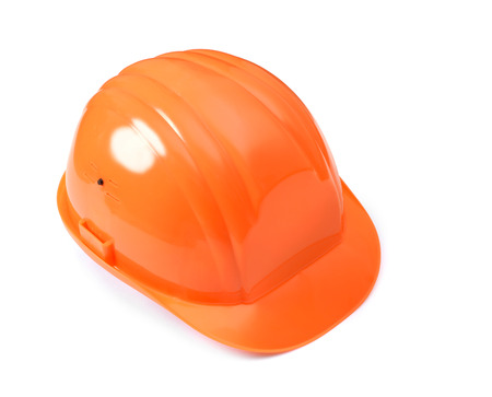 Orange hard hat isolated silhouette with clipping path on white background. photo