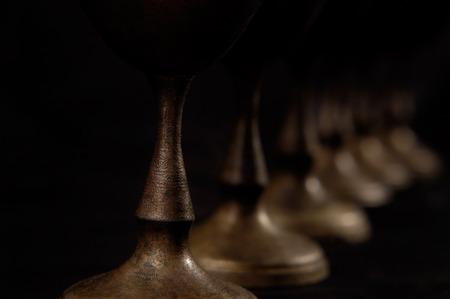 stemware: Antique decorative vintage silver stemware abstract close-up on black background