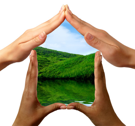 environmental safety: Conceptual symbol home made by black and white people hands framing the nature scenery isolated on white background Stock Photo