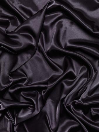 shiny black: Black shiny silky fabric abstract folds background texture