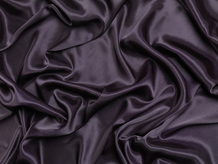 shiny background: Black shiny silky fabric abstract background texture Stock Photo