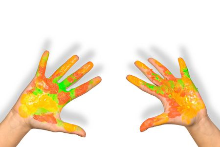 soiled: Childrens hands soiled with paints on a white background Stock Photo