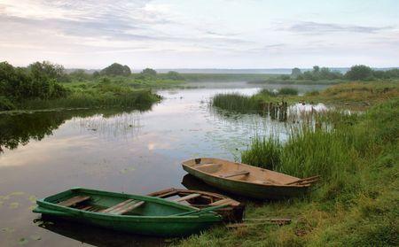 bulrushes: boats beside riverside matutinal landscape