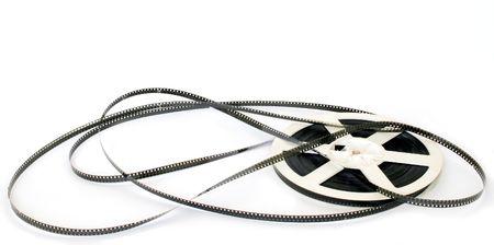 movie pelicula: La pel�cula de cine es uncoilled de spool de fondo blanco  Foto de archivo