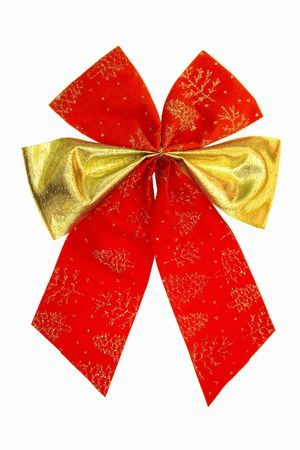 isolated red bow with gold strip against white background photo