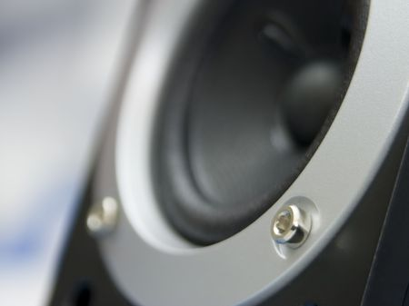 Speaker with silver ring in a soft focus
