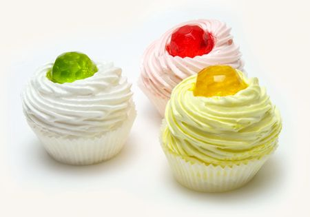 puffs: three cream puffs with colored jelly Stock Photo