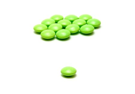 green pills against white backgrouns Stock Photo - 786424